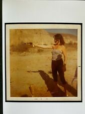Vintage Odd photo of sexy woman shooting  pistol in the desert,  c1978