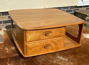 1970s Mid century Ercol Pandora's box coffee table solid elm bookcase drawers