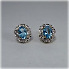 9ct Gold Blue Topaz and Diamonds Stud Earrings