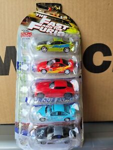 RACING CHAMPIONS THE FAST AND THE FURIOUS 5 PACK SET. CARS MINT, CARD OK OPENED