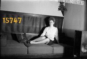vintage negative! pretty woman on bed, nylon stockings, mini skirt, legs, shadow