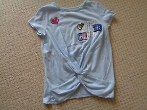GIRLS CALVIN KLEIN  Blue top.  Never worn.    Size. M. 8-10