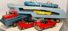 VINTAGE JAPANESE TIN LITHOGRAPHED CAR HAULER W/ 5 TIN FRICTION TOY CARS
