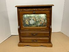 MUSICAL VINTAGE JEWELRY BOX, ONE DOOR AND 2 DRAWERS, DOOR HAS TAPESTRY ON FRONT.