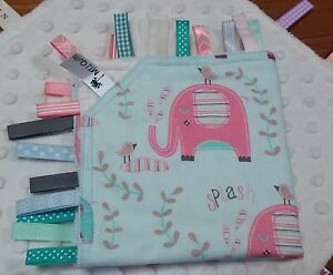 Taggie Blanket pink elephants on aqua with cream dimple minky backing