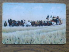 Great PC of 20plus horses pulling early Combine Harvester--  Canada ?  Colour