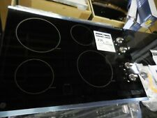 GE 30-in 4 Elements Smooth Surface Stainless Steel Electric Cooktop