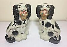 Pair of Staffordshire Dogs Holding Baskets