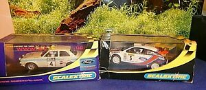 TWO     SCALEXTRIC     CARS  BOXED.