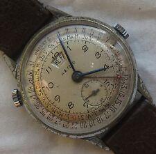Triple Date mens wristwatch nickel chromiun case load manual 34 mm. in diameter