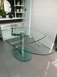 beautiful glass extending dining table