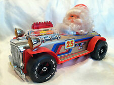 Vintage 1970s Battery Operated Tin and Plastic Santa Claus in Race Car Toy