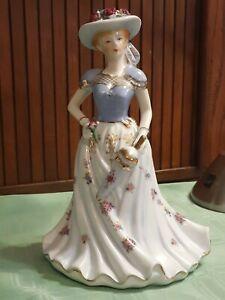 Porcelain Coalport Southern Belle Figurine Parasol & Hat Floral Dress, and Hat.