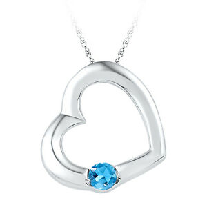 10K White Gold 0.15ctw Diamond Blue Topaz Pendant