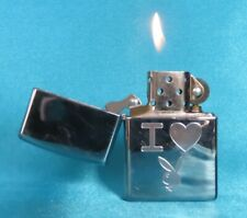 """Collectable 2002 Bright Chrome """"I Love Playboy"""" Zippo Lighter."""