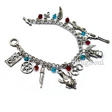 11 Supernatural Themed Charm Bracelet - Car, Revolver,Wings & Logo with Crystals
