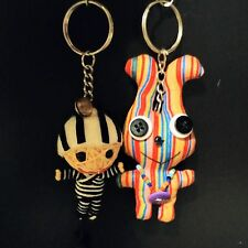 2 key chains of Fabric bunny doll and string voodoo doll