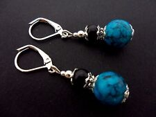 A PAIR BLACK AND TURQUOISE GLASS PEARL  SILVER PLATED LEVERBACK HOOK EARRINGS.