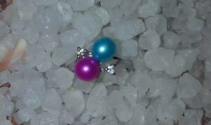 Sterling Silver Adjustable Ring with 2 color Pearls on it.