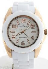 AK Anne Klein Women's 10-9640 White Plastic Band Rose Gold Case White Dial Watch