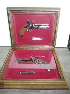 Intercraft Pill Lock 1885 & Flintlock 1796 Pistols in Shadow Box, Gold & Red