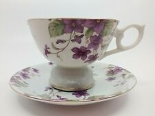 LEFTON CHINA 1991 SIGNED PURPLE FLORAL  MUSICAL TEA CUP AND SAUCER