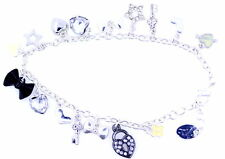 Silver tone chain bracelet with various charms, heart, bow, key