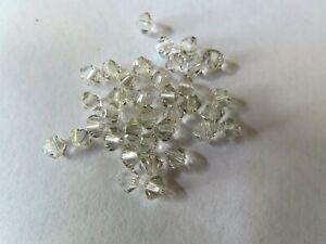 36 Swarovski XILION Crystal Bicone beads in 4mm Crystal Silver shade. #5328