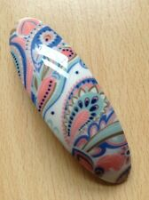 An Ivory Paisley Design Oval Barrette Hair Clip
