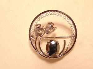 Round sterling silver pin with large gray stone - marked Zeidell's sterling