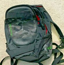 Dakine Urban Camo Backpack with Skateboard holding Strap