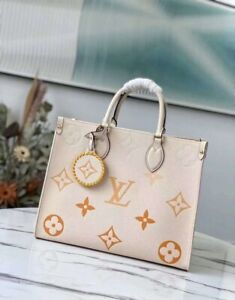 Louis Vuitton onthego MM M45717 cream and safran 100% authentic