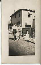 POST CARD WITH REAL PHOTO OF A FAMILY  IN THE BACK YARD