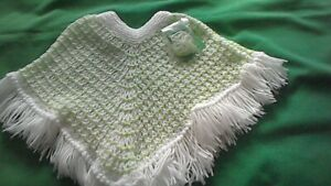 Hand-knitted  child's  white with lime green poncho  age 2