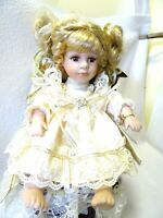 "8"" PORCELAIN DOLL ""VERONICA"" IN WOODEN CHAIR-MUSIC BOX-WITH COA-BLOND HAIR-BROWN"