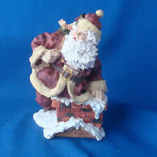 resin stoneware figurine Christmas Santa Claus climbing down chimney with gifts