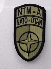 ARMY PATCH, NATO TRING MISSION AFGHAN, ALL GREEN SCORPION W/ HOOK TAPE FASTENER