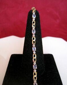 10K YELLOW GOLD OVAL BLUE TOPAZ & DIAMONDS TENNIS LINK BRACELET 7 INCHES