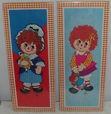 Two  NEW Vintage  Lyn Raggedy Ann  Pictures by Soroka Wall Plaques Holding Dolls