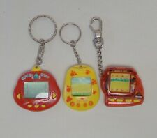 3-ELECTRONIC GAME KEYCHAINS~GIGA PET LOST WORLD~DINKIE DINO~DOG PAW PRINTS ON IT