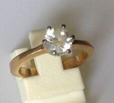bague solitaire signé anneau couleur or griffes couleur argent taille 51