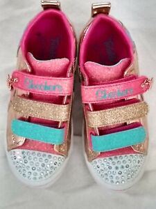 Girls Twinkle toes sketchers size 10 with flashing toe lights.