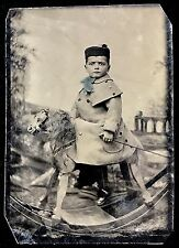 RARE & SUPERB 1/6 PLATE TINTYPE OF A SERIOUS BOY RIDING HIS ROCKING HORSE STEED