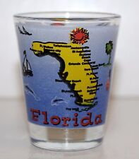 Shot Glass FLORIDA yellow map of Florida with cities listed sounded by ocean.