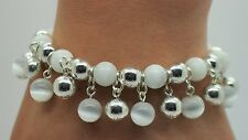 NEW  WHITE CAT EYE/ SILVER ROUND BEAD VERY CUTE  FASHION STRETCH CHARMS BRACELET