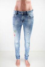 Klassische Damen-Jeans-Normalgröße und/Fetzen
