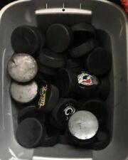 50 USED ICE HOCKEY pucks