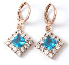 Women's 18 Carat Rose Gold Plated Ice Blue Zircon Drop Huggie Earrings Jewellery