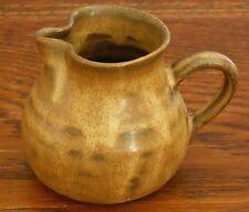 A hand made little brown Prinknash Jug