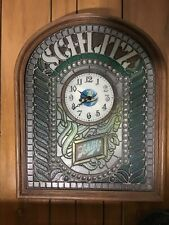 Vintage Schlitz plastic multi colored lighted beer sign and clock